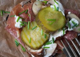 Smørrebrød with salami, ham and mushrooms