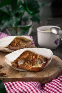 Bavarian pita with beef and pork meatloaf, sauerkraut and roasted onions